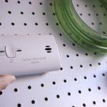 close up shot of carbon monoxide alarm near garage