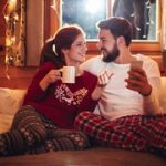 couple in their home on a cold night wearing winter pajamas