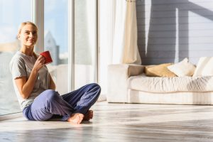 smiling woman sitting in home looking comfortable