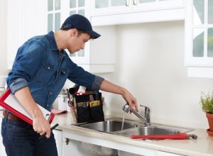 professional-plumber-doing-reparation-in-kitchen-home