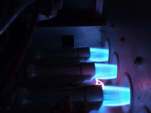 three-gas-jets-igniting-blue-flame
